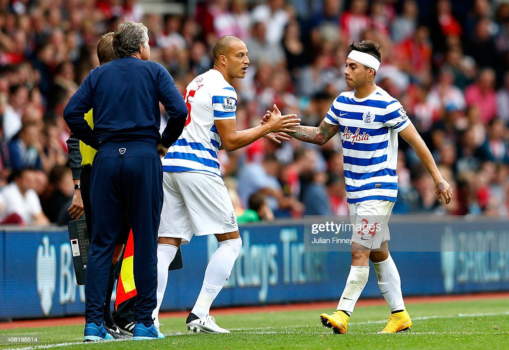 Bobby Zamora (C) of QPR comes on as a substitue for Eduardo Vargas during the Barclays Premier League match between Southampton and Queens Park Rangers at St Mary's Stadium on September 27, 2014 in Southampton, England.