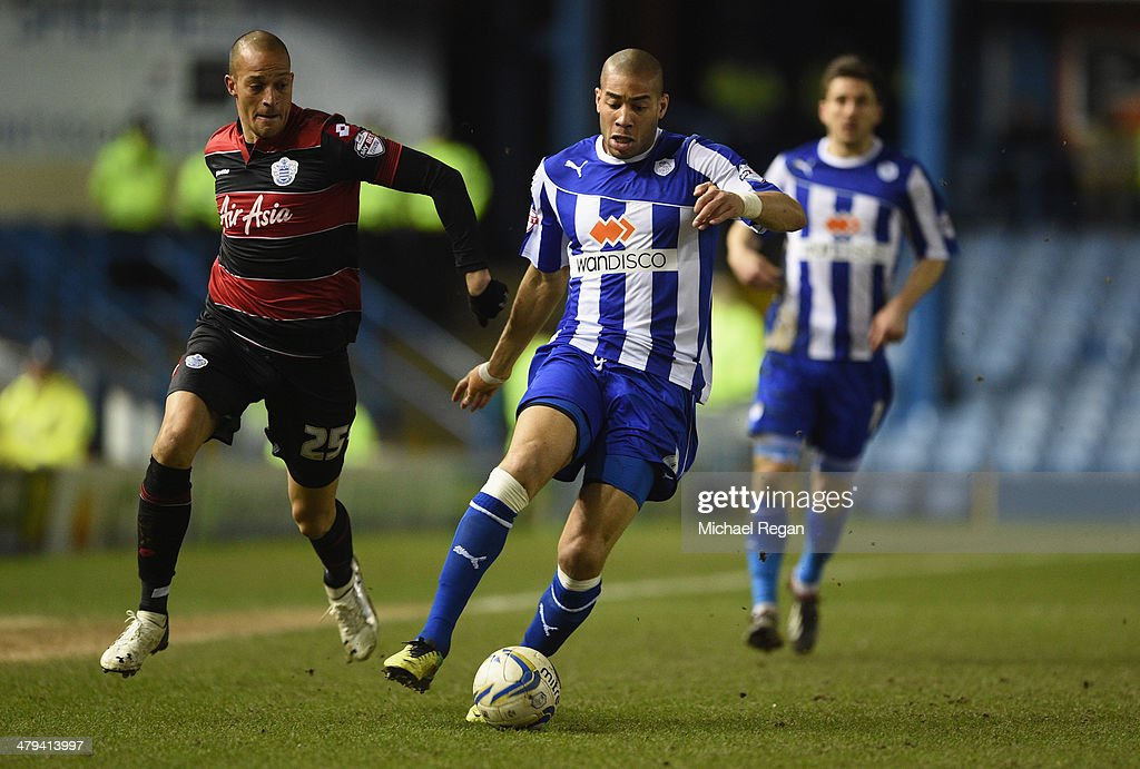 Bobby Zamora of QPR in action with Oguchi Onyewu of Sheffield Wednesday during the Sky Bet Championship match between Sheffield Wednesday and Leeds United at Hillsborough Stadium on January 11, 2014 in Sheffield, England,