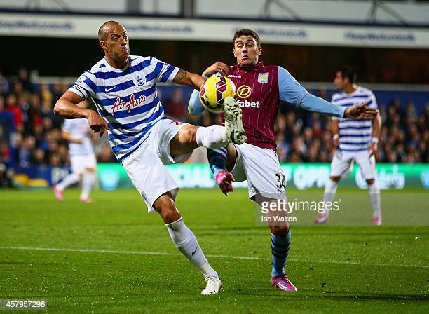 Bobby Zamora of QPR is challenged by Matthew Lowton of Aston Villa during the Barclays Premier League match between Queens Park Rangers and Aston...
