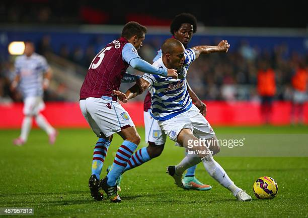 Bobby Zamora of QPR is closed down by Ashley Westwood and Carlos Sanchez of Aston Villa during the Barclays Premier League match between Queens Park...