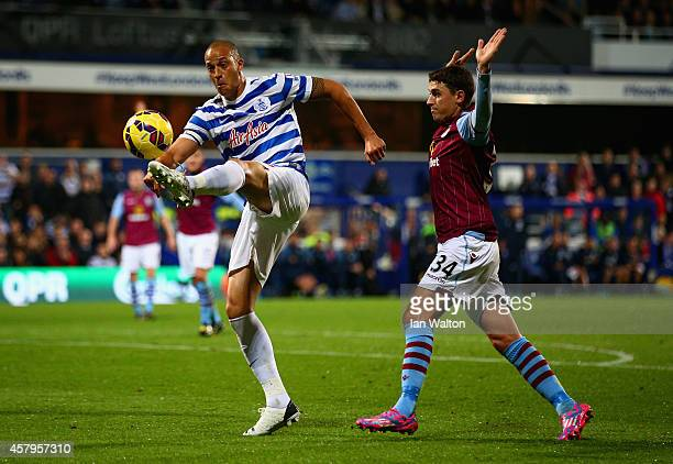Bobby Zamora of QPR is marshalled by Matthew Lowton of Aston Villa during the Barclays Premier League match between Queens Park Rangers and Aston...