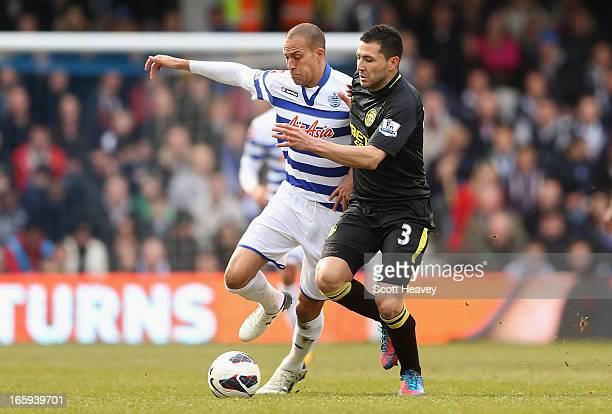 Bobby Zamora of Queens Park Rangers and Antolin Alcaraz of Wigan Athletic battle for the ball during the Barclays Premier League match between Queens...