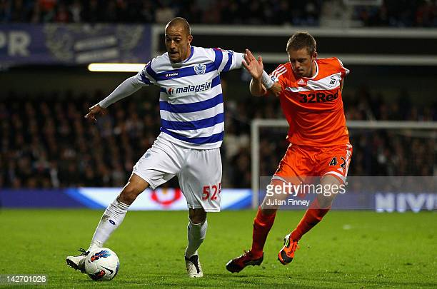 Bobby Zamora of Queens Park Rangers is closed down by Gylfi Sigurdsson of Swansea City during the Barclays Premier League match between Queens Park...