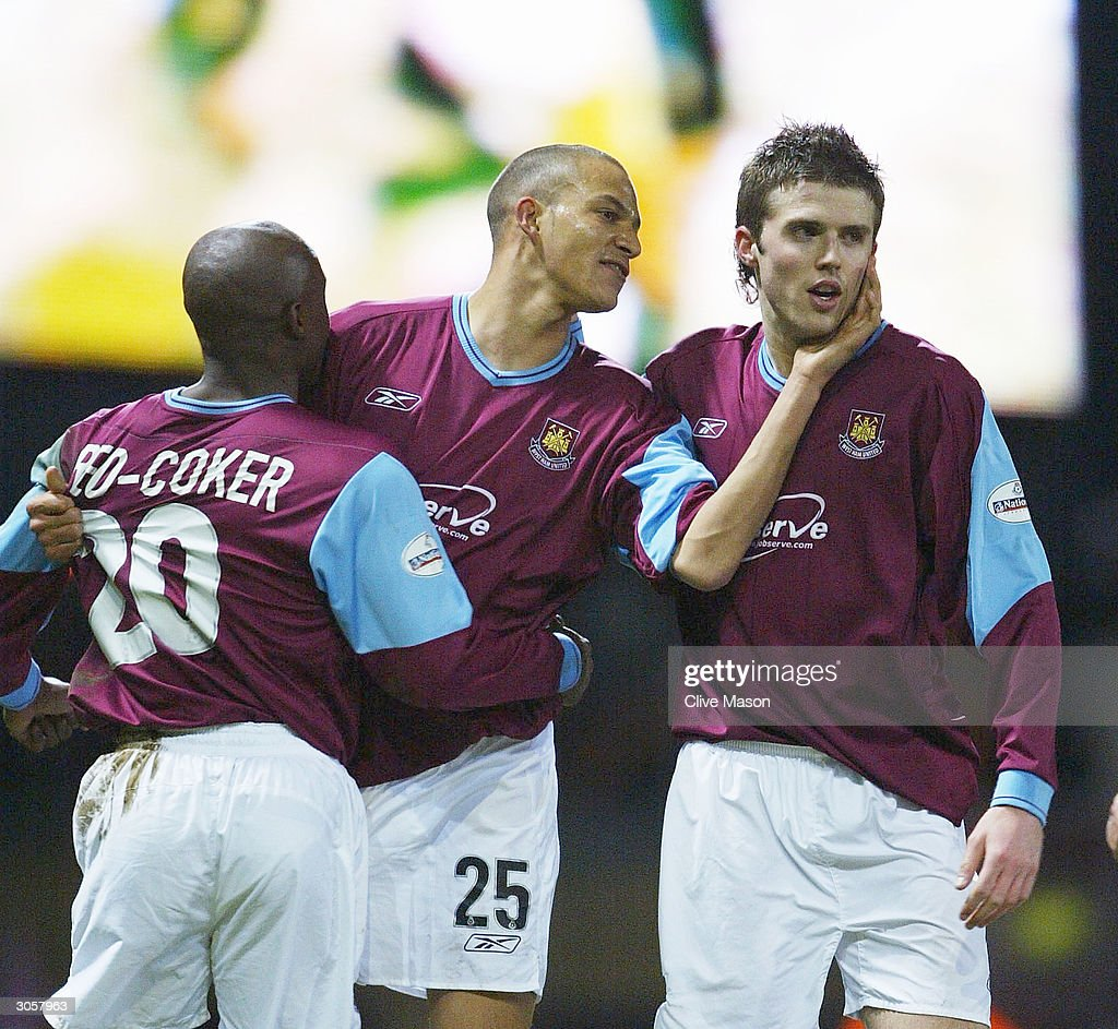 Bobby Zamora of West Ham celebrates with team mate Bobby Zamora during the Nationwide Division One match between West Ham United and Wimbledon at Upton Park on March 9, 2004 in London.