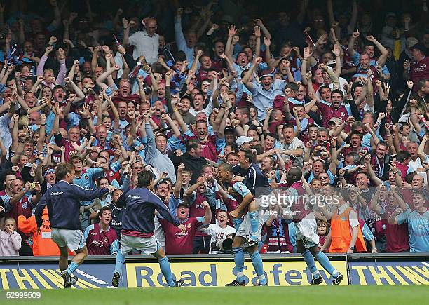 Bobby Zamora of West Ham celebrates with teammates as the Hammers fans go wild during the CocaCola Championship PlayOff Final between West Ham United...