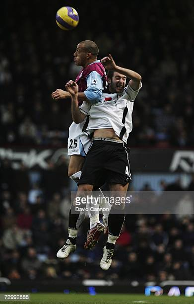 Bobby Zamora of West Ham United challenges Frank Queudrue of Fulham during the Barclays Premiership match between West Ham United and Fulham at Upton...