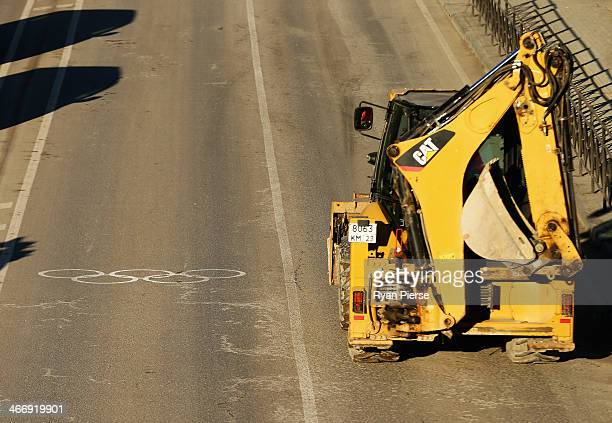 A bobcat is seen driving next to an Olympic lane near the Gorki Media Centre in the Rosa Khutor Moutain Cluster on February 5 2014 in Sochi Russia