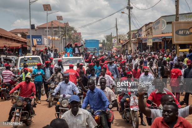 Bobi Wine, aka Robert Kyagulanyi, is being driven through the streets while campaigning in Hoima. Wine aka Robert Kyagulanyi, campaigned in Hoima...