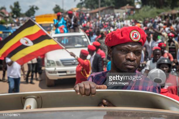 "Bobi Wine and ""people power"" opposition supporter takes part during the rally in Hoima, Wine aka Robert Kyagulanyi, campaigned in Hoima ahead of a..."