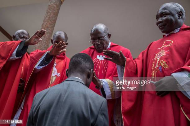 Bobi Wine being blessed by priests at a Catholic thanksgiving during a campaign event in Gombe Bobi Wine whose real name is Robert Kyagulanyi a...