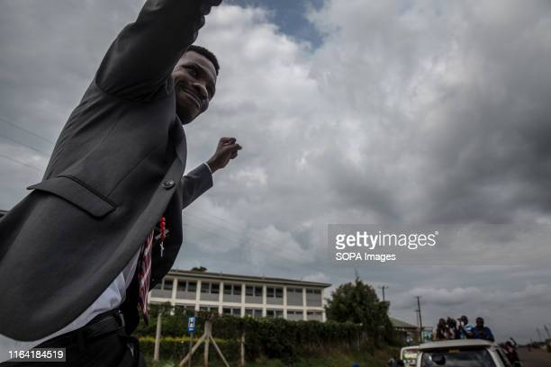 Bobi Wine waves to supporters during a campaign event in Gombe Bobi Wine whose real name is Robert Kyagulanyi a popstar and opposition leader under...