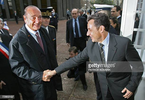 French President Jacques Chirac shakes hands with Interior Minister Nicolas Sarkozy as he arrives at the prefecture to present his New Year Wishes to...