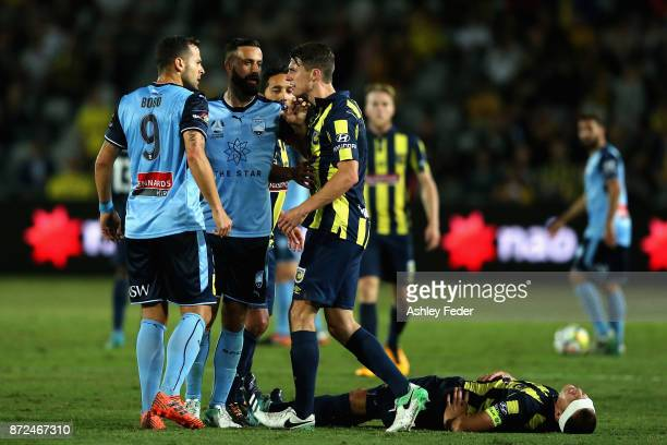 Bobo and Alex Brosque of Sydney FC have an altercation with Jake McGing of the Mariners with Alan Baro of the Mariners lying on the ground during the...