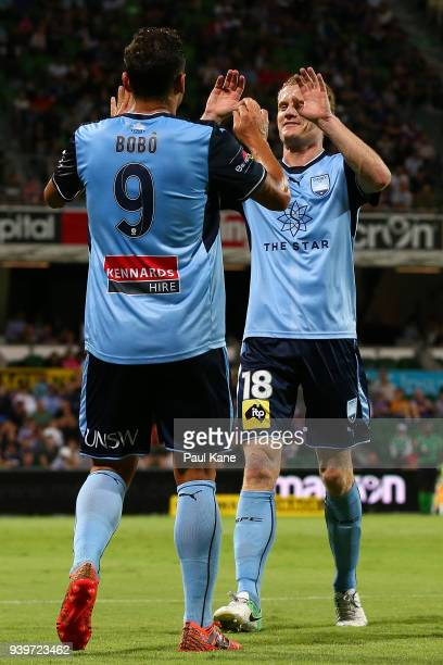 Bobo and Matt Simon of Sydney celebrate a goal during the round 25 ALeague match between the Perth Glory and Sydney FC at nib Stadium on March 29...