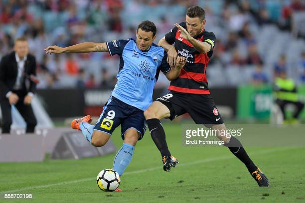 Bobo of Sydney and Robert Cornthwaite of the Wanderers contests the ball during the round 10 ALeague match between the Western Sydney Wanderers and...
