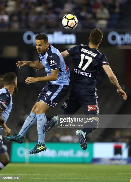 Bobo of Sydney FC and James Donachie of the Victory compete for the ball during the round one ALeague match between the Melbourne Victory and Sydney...