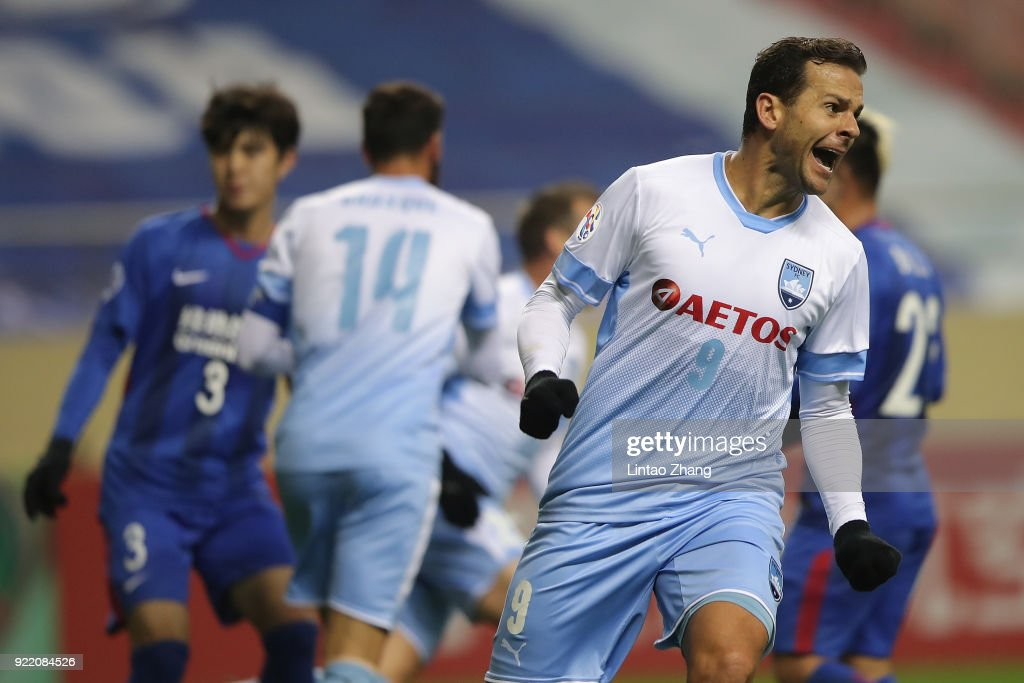 Bobo of Sydney FC celebrates a goal form team mate Luke Wilkshire during the AFC Champions League Group H match between Shanghai Shenhua FC and Sydney FC at Hongkou Stadium on February 21, 2018 in Shanghai, China.