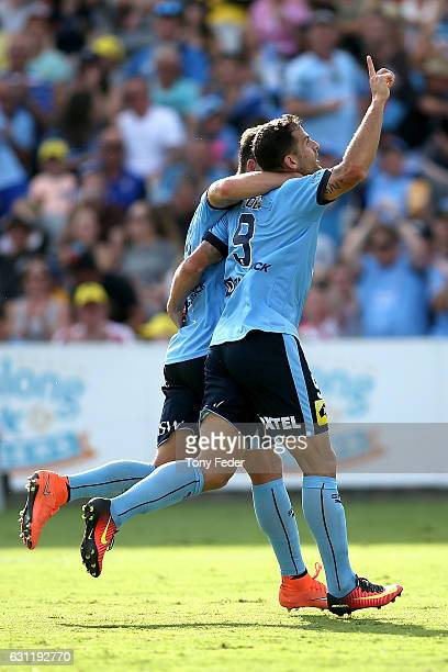 Bobo of Sydney FC celebrates a goal with team mate Filip Holosko during the round 14 A-League match between the Central Coast Mariners and Sydney FC...
