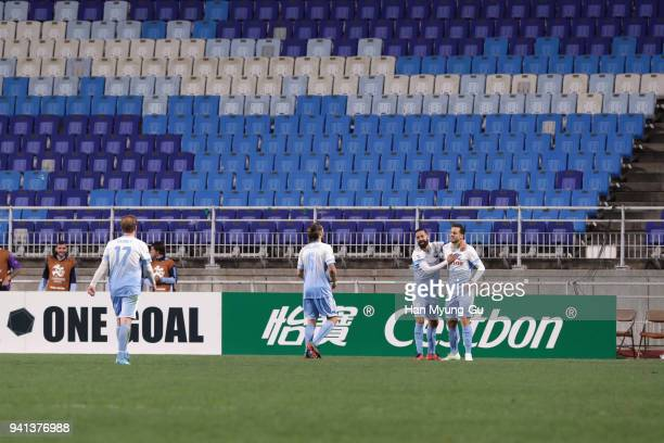 Bobo of Sydney FC celebrates scoring his side's fourth goal with his team mates during the AFC Champions League Group H match between Suwon Samsung...