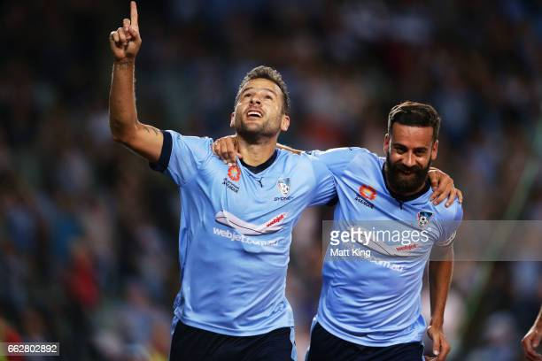 Bobo of Sydney FC celebrates with Alex Brosque of Sydney FC after scoring a goal during the round 25 ALeague match between Sydney FC and Melbourne...