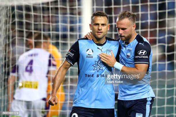 Bobo of Sydney FC celebrates with his team mate Jordy Buijs of Sydney FC after scoring a goal during the round four ALeague match between Sydney FC...