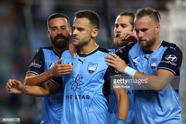 Bobo of Sydney FC celebrates with his team mates Alex Brosque Joshua Brilliante and Jordy Buijs of Sydney FC after scoring a goal during the round...