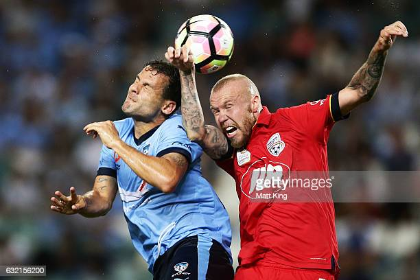 Bobo of Sydney FC competes for a header against Taylor Regan of United during the round 16 ALeague match between Sydney FC and Adelaide United at...