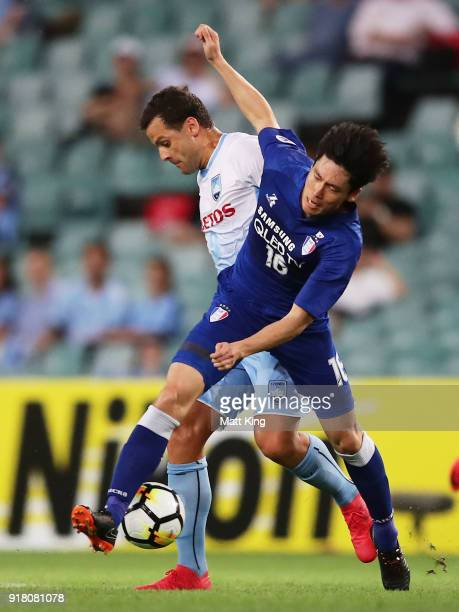 Bobo of Sydney FC competes for the ball against Lee JongSung of the Bluewings during the AFC Asian Champions League match between Sydney FC and Suwon...