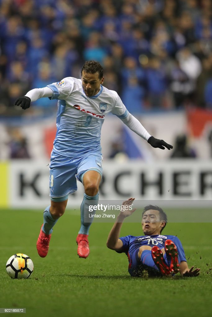 BoBo of Sydney FC competes the ball with Zhang Lu of Shanghai Shenhua FC during the AFC Champions League Group H match between Shanghai Shenhua FC and Sydney FC at Hongkou Stadium on February 21, 2018 in Shanghai, China.