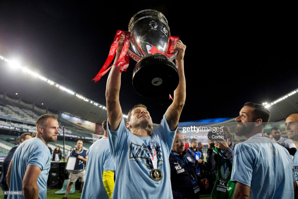 Bobo of Sydney FC holds up the FFA Cup in front of the Cove during the FFA Cup Final match between Sydney FC and Adelaide United at Allianz Stadium on November 21, 2017 in Sydney, Australia.