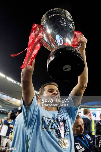 Bobo of Sydney FC holds up the FFA Cup in front of the Cove during the FFA Cup Final match between Sydney FC and Adelaide United at Allianz Stadium...