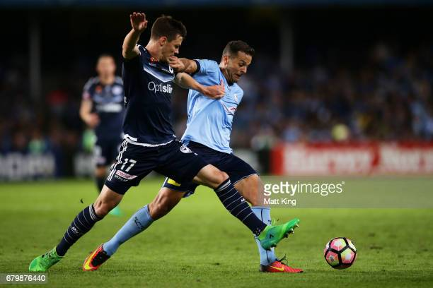 Bobo of Sydney FC is challenged by James Donachie of Melbourne Victory during the 2017 ALeague Grand Final match between Sydney FC and the Melbourne...