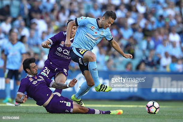Bobo of Sydney FC is tackled by Rhys Williams of the Glory during the round six ALeague match between the Sydney Kings and the Perth Widcats at...