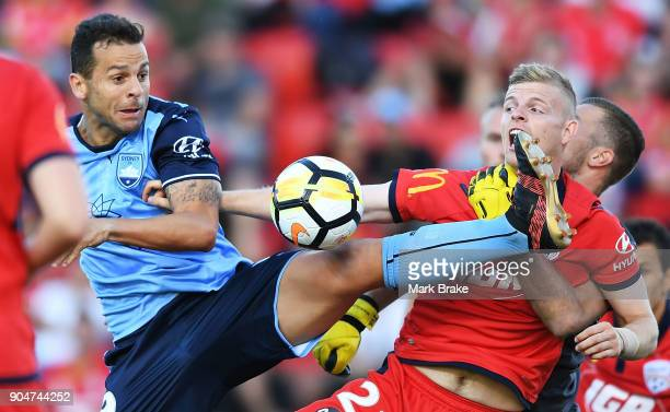 Bobo of Sydney FC kicks for goal tackled by Jordan Elsey of Adelaide United and keeper Daniel Margush of Adelaide United during the round 16 ALeague...