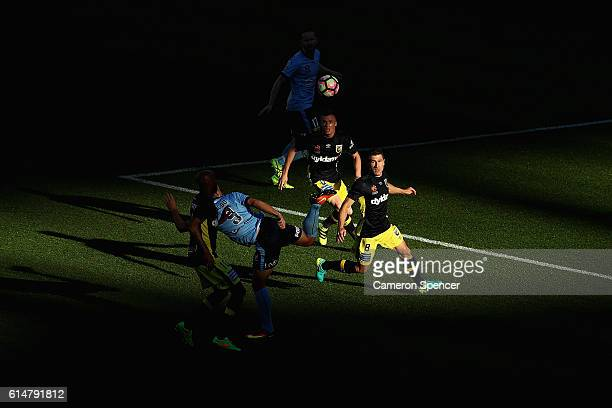 Bobo of Sydney FC kicks the ball ahead of Nick Montgomery of the Mariners during the round two A-League match between Sydney FC and the Central Coast...