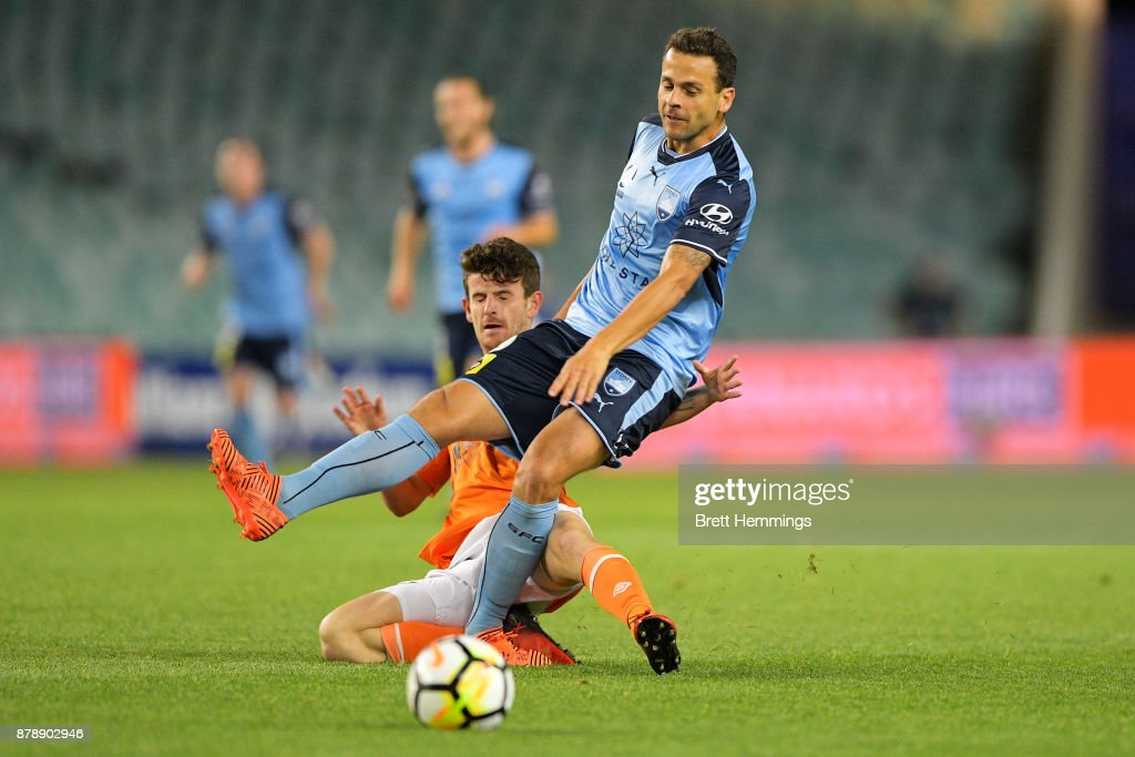 Bobo of Sydney is tackled by Mitchell Oxborrow of Brisbane during the round eight A-League match between Sydney FC and the Brisbane Roar at Allianz Stadium on November 25, 2017 in Sydney, Australia.