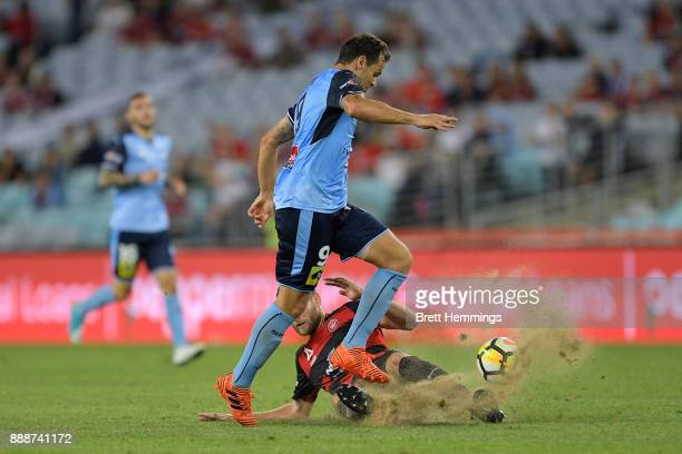 Bobo of Sydney is tackled during the round 10 ALeague match between the Western Sydney Wanderers and Sydney FC at ANZ Stadium on December 9 2017 in...