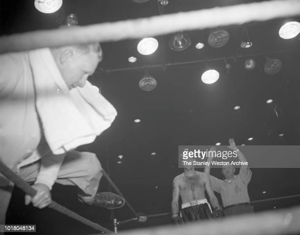 Bobo Olson heads back to his corner after finishing a round of boxing against Kid Gavilan in Chicago Stadium Chicago Illinois April 2 1954 Bobo Olson...