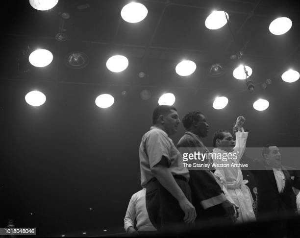 Bobo Olson in white is declared the World Middle Weight Champion for a majority 15 round decision against Kid Gavilan in Chicago Stadium Chicago...