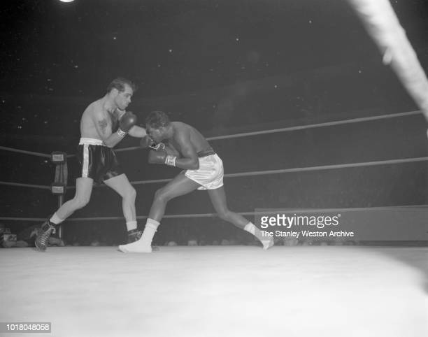 Bobo Olson throws a left hook as Kid Gavilan tries to duck and move in during their bout in Chicago Stadium Chicago Illinois April 2 1954 Bobo Olson...