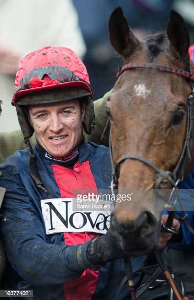 Bobs Worth and Barry Geraghty celebrate winning the Gold Cup on day 4 of the Cheltenham Festival on Gold Cup Day at Cheltenham racecourse on March...