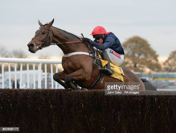 Bobs Worth and Barry Geraghty, the Cheltenham Gold Cup Winner, struggle to get over the final fence in the Betfair Chase during the Betfair Chase...