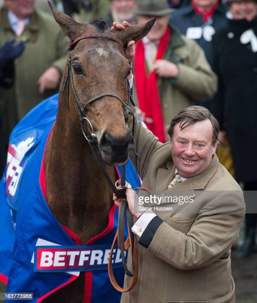 Bobs Worth and trainer Nicky Henderson celebrate winning the Gold Cup on day 4 of the Cheltenham Festival on Gold Cup Day at Cheltenham racecourse on...