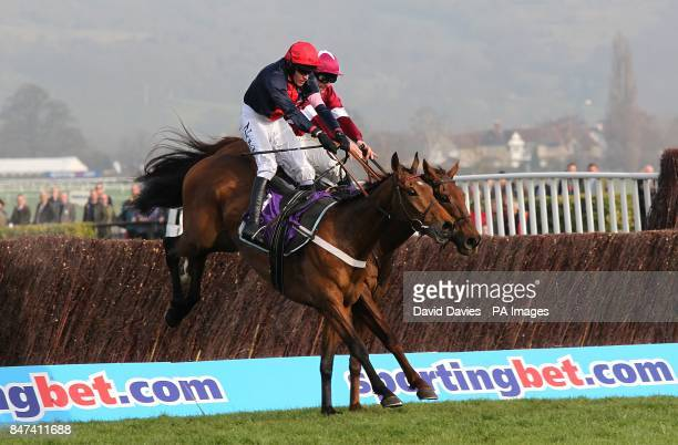 Bobs Worth ridden by Barry Geraghty clears a fence ahead of First Lieutenant ridden by Davy Russell on the way to winning the RSA Chase on Ladies...