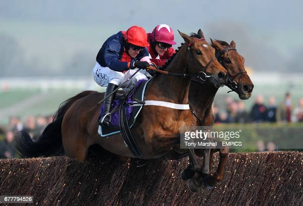Bobs Worth ridden by jockey Barry Geraghty alongside First Lieutenant ridden by Davy Russell on the way to victory during the RSA Chase during Ladies...