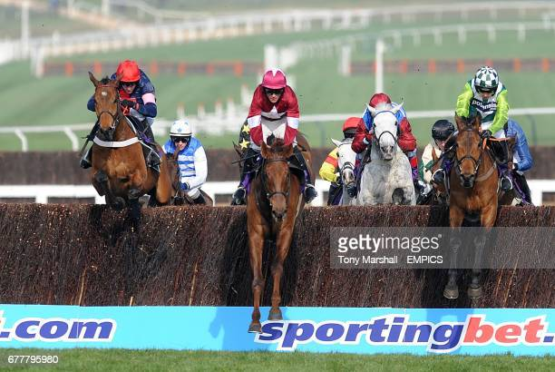 Bobs Worth ridden by jockey Barry Geraghty alongside First Lieutenant ridden by Davy Russell and Join Together ridden by Ruby Walsh during the RSA...