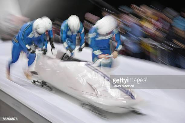 bobsled competition start. - bobsleigh stock pictures, royalty-free photos & images