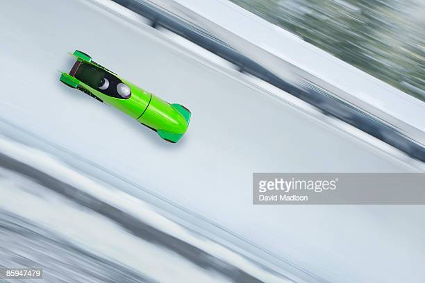 bobsled on track with motion blur. - bobsleigh stock pictures, royalty-free photos & images