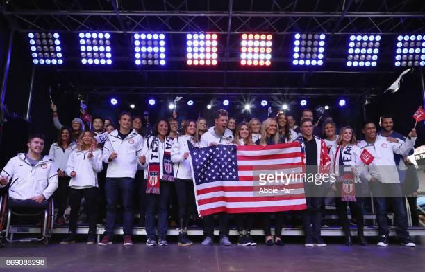 Bobsledder Elana Meyers Taylor snowboarder Alex Deibold skier Lindsey Vonn skier Gus Kenworthy figure skater Ashley Wagner and Team USA pose for a...