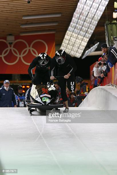 Bobsleigh 2006 Winter Olympics USA Todd Hays and Pavle Jovanovic in action during start of Two Man Heat 2 at Cesana Pariol Cesana Italy 2/18/2006